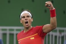 2016 Rio Olympics - Tennis - Preliminary - Men's Singles First Round - Olympic Tennis Centre - Rio de Janeiro, Brazil - 07/08/2016. Rafael Nadal (ESP) of Spain celebrates after winning his match against Federico Delbonis (ARG) of Argentina. REUTERS/Toby Melville
