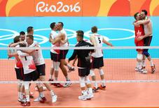 2016 Rio Olympics - Volleyball - Men's Preliminary - Pool A USA v Canada - Maracanazinho - Rio de Janeiro, Brazil - 07/08/2016. Canadian team players celebrate after defeating the USA.  REUTERS/Marcelo Del Pozo