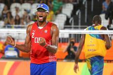 2016 Rio Olympics - Beach Volleyball - Men's Preliminary - Beach Volleyball Arena - Rio de Janeiro, Brazil - 07/08/2016. Sergio Gonzalez (CUB) of Cuba reacts.  REUTERS/Ruben Sprich