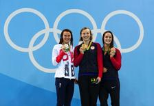 Aug 7, 2016; Rio de Janeiro, Brazil; Jazz Carlin (GBR) , Leah Smith (USA) and Katie Ledecky (USA) with their medals after the women's 400m freestyle final in the Rio 2016 Summer Olympic Games at Olympic Aquatics Stadium. Mandatory Credit: Rob Schumacher-USA TODAY Sports