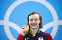 2016 Rio Olympics - Swimming - Victory Ceremony - Women's 200m Freestyle Victory Ceremony - Olympic Aquatics Stadium - Rio de Janeiro, Brazil - 09/08/2016. Katie Ledecky (USA) of USA poses with her gold medal   REUTERS/David Gray