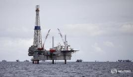 L'Arabie saoudite, premier exportateur mondial de pétrole, a porté sa production de brut à un niveau record en juillet, a-t-elle déclaré à l'Opep, signe que les principaux pays membres du cartel continuent de privilégier la défense de leurs parts de marché au détriment du rééquilibrage entre l'offre et la demande /Photo d'archives/REUTERS/Andrea De Silva