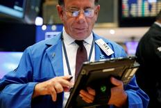 A trader works on the floor of the New York Stock Exchange (NYSE) shortly after the opening bell in New York, U.S., August 9, 2016. REUTERS/Lucas Jackson  - RTSM2RW