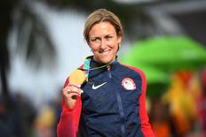 Aug 10, 2016; Rio de Janeiro, Brazil; Kristin Armstrong (USA) waves in the women's individual time trial medal ceremony at Pontal during the Rio 2016 Summer Olympic Games. Mandatory Credit: Jack Gruber-USA TODAY Sports