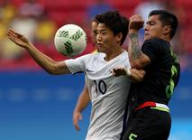 Seungwoo Ryu , da Coreia do Sul, e Michael Perez, do México  10/08/2016 REUTERS/Ueslei Marcelino