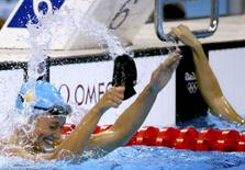 Mireia Belmonte of Spain celebrates winning gold in the 200m butterfly final.   REUTERS/David Gray