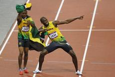 Jamaica's Usain Bolt (R) and Yohan Blake celebrate after they won gold in the men's 4x100m relay final at the London 2012 Olympic Games at the Olympic Stadium August 11, 2012. REUTERS/Gary Hershorn(