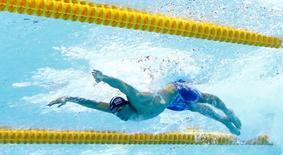 Michael Phelps competes. REUTERS/Michael Dalder