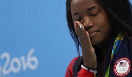 Simone Manuel cries.  REUTERS/Stefan Wermuth