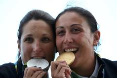 2016 Rio Olympics - Shooting - Victory Ceremony - Women's Skeet Victory Ceremony - Olympic Shooting Centre - Rio de Janeiro, Brazil - 12/08/2016. Chiara Cainero (ITA) and Diana Bacosi (ITA) of Italy pose with their medals.  REUTERS/Edgard Garrido