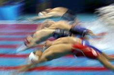 2016 Rio Olympics - Swimming - Preliminary - Men's 4 x 100m Medley Relay - Heats - Olympic Aquatics Stadium - Rio de Janeiro, Brazil - 12/08/2016. Competitors start.  REUTERS/Stefan Wermuth