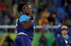 2016 Rio Olympics - Athletics - Final - Women's Shot Put Final - Olympic Stadium - Rio de Janeiro, Brazil - 12/08/2016.  Michelle Carter (USA) of USA celebrates after winning the gold medal in the women's shot put. REUTERS/Phil Noble
