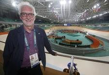 2016 Rio Olympics - Cycling Track - Preliminary - Team training - Rio Olympic Velodrome - Rio de Janeiro, Brazil - 08/08/2016. UCI president Brian Cookson stands near the track during a practice session.  REUTERS/Eric Gaillard