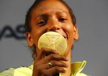 2016 Rio Olympics - Judo - Women - 57 kg - Rio de Janeiro, Brazil - 09/08/2016. Rafaela Silva holds her gold medal during a press conference. REUTERS/Nacho Doce