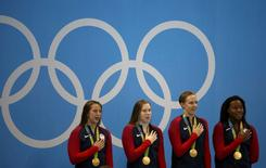 2016 Rio Olympics - Swimming - Victory Ceremony - Women's 100m Medley Relay Victory Ceremony - Olympic Aquatics Stadium - Rio de Janeiro, Brazil - 13/08/2016. Team USA sing their national anthem. REUTERS/Marcos Brindicci