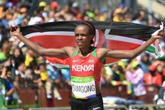 2016 Rio Olympics - Athletics - Final - Women's Marathon -Sambodromo - Rio de Janeiro, Brazil - 14/08/2016. Jemima Sumgong (KEN) of Kenya celebrates after winning the race        REUTERS/Johannes Eisele/Pool