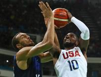 2016 Rio Olympics - Basketball - Preliminary - Men's Preliminary Round Group A USA v France - Carioca Arena 1 - Rio de Janeiro, Brazil - 14/08/2016. Kyrie Irving (USA) of the USA shoots over Rudy Gobert (FRA) of France. REUTERS/Jim Young