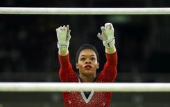 2016 Rio Olympics - Artistic Gymnastics - Final - Women's Uneven Bars Final - Rio Olympic Arena - Rio de Janeiro, Brazil - 14/08/2016. Gabrielle Douglas (USA) of USA (Gabby Douglas) competes. REUTERS/Mike Blake