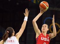 2016 Rio Olympics - Basketball - Preliminary - Women's Preliminary Round Group B China v USA - Youth Arena - Rio de Janeiro, Brazil - 14/08/2016. Sun Mengran (CHN) of China and Breanna Stewart (USA) of USA compete. REUTERS/Shannon Stapleton