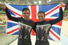 2016 Rio Olympics - Cycling Track - Final - Men's Sprint Final Gold Race - Rio Olympic Velodrome - Rio de Janeiro, Brazil - 14/08/2016. Gold medalist Jason Kenny (GBR) of Britain poses with silver medalist Callum Skinner (GBR) of Britain. REUTERS/Matthew Childs