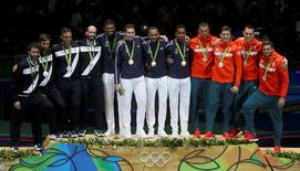 2016 Rio Olympics - Fencing - Victory Ceremony - Men's Epee Team Victory Ceremony - Carioca Arena 3 - Rio de Janeiro, Brazil - 14/08/2016. France celebrates winning the gold medal with Italy and Hungary. REUTERS/Pilar Olivares