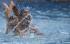 2016 Rio Olympics - Synchronised Swimming - Duets Free Routine - Final - Maria Lenk Aquatics Centre - Rio de Janeiro, Brazil - 16/08/2016.   Natalia Ishchenko (RUS) and Svetlana Romashina (RUS) of Russia compete. REUTERS/Michael Dalder
