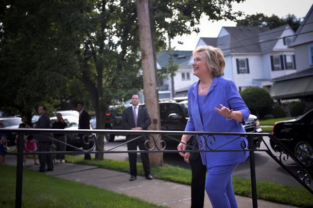Hillary Clinton and Vice-President Joe Biden stopped to visit Biden's childhood home in Scranton, Pennsylvania. REUTERS/Charles Mostoller