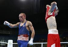 Irlandês Conlan tira a camisa após luta contra russo Nikitin na Rio 2016. REUTERS/Peter Cziborra