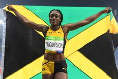 Aug 17, 2016; Rio de Janeiro, Brazil; Elaine Thompson (JAM) celebrates after winning a gold medal during the women's 200m final in the Rio 2016 Summer Olympic Games at Estadio Olimpico Joao Havelange. Mandatory Credit: Christopher Hanewinckel-USA TODAY Sports