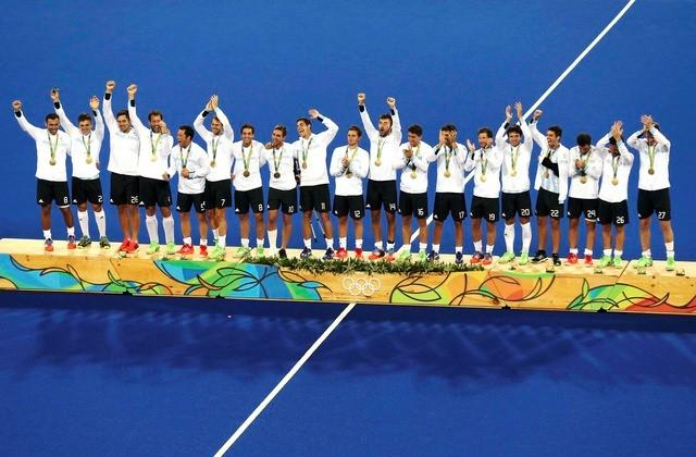Argentina hold off Belgium to take men's gold