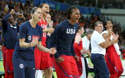 2016 Rio Olympics - Basketball - Women's Semifinal France v USA - Carioca Arena 1 - Rio de Janeiro, Brazil - 18/8/2016. Head Coach Geno Auriemma (USA) of USA (2nd from R) and his players cheer from the bench during the game. REUTERS/Shannon Stapleton