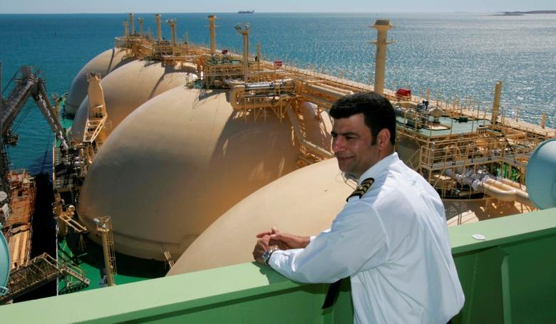 Cornelius Johnston, master of the gas transport ship North West Eagle overlooks the first shipment of LNG (Liquefied Natural Gas) to depart from the Pilbara region of Western Australia for China May 17, 2006. REUTERS/Kerry Edwards