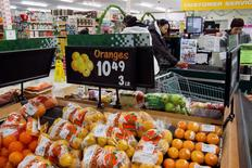Prices are displayed for oranges at a store in Atawapiskat, Ontario, December 17, 2011.  REUTERS/Frank Gunn/Pool