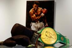 Belongings and the iconic 'Rumble in the Jungle' belt of late boxing champion Muhammad Ali are displayed for auction at Heritage Auctions house in Manhattan, New York, U.S., August 19, 2016. REUTERS/Eduardo Munoz