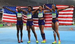 2016 Rio Olympics - Athletics - Final - Women's 4 x 100m Relay Final - Olympic Stadium - Rio de Janeiro, Brazil - 19/08/2016. Tianna Bartoletta (USA) Allyson Felix (USA) English Gardner (USA) and Tori Bowie (USA) of USA celebrate after winning the race    REUTERS/Dominic Ebenbichler