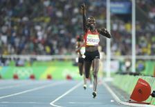 2016 Rio Olympics - Athletics - Final - Women's 5000m Final - Olympic Stadium - Rio de Janeiro, Brazil - 19/08/2016. Vivian Cheruiyot (KEN) of Kenya celebrates winning the gold. REUTERS/Lucy Nicholson
