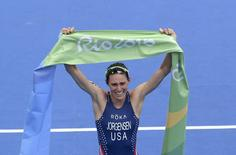 2016 Rio Olympics - Triathlon - Final - Women's Final - Fort Copacabana - Rio de Janeiro, Brazil - 20/08/2016. Gold medalist Gwen Jorgensen (USA) of USA reacts. REUTERS/Toby Melville