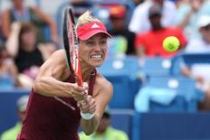 Aug 20, 2016; Mason, OH, USA; Angelique Kerber (GER) returns a shot against Simona Halep (ROU) in the semifinals during the Western and Southern tennis tournament at Linder Family Tennis Center. Mandatory Credit: Aaron Doster-USA TODAY Sports