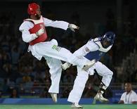 Brasileiro Maicon Siqueira (E) durante luta com britânico Mahama Cho na Rio 2016 20/08/2016 REUTERS/Issei Kato