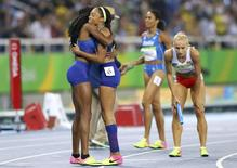 2016 Rio Olympics - Athletics - Final - Women's 4 x 400m Relay Final - Olympic Stadium - Rio de Janeiro, Brazil - 20/08/2016. Phyllis Francis (USA) of USAAllyson Felix (USA) of USA embrace after winning gold. REUTERS/Ivan Alvarado