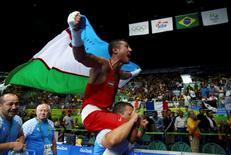 2016 Rio Olympics - Boxing - Final - Men's Light Welter (64kg) Final Bout 272 - Riocentro - Pavilion 6 - Rio de Janeiro, Brazil - 21/08/2016. Fazliddin Gaibnazarov (UZB) of Uzbekistan celebrates after winning his bout.  REUTERS/Peter Cziborra