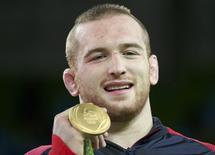 2016 Rio Olympics - Wrestling - Victory Ceremony - Men's Freestyle 97 kg Victory Ceremony - Carioca Arena 2 - Rio de Janeiro, Brazil - 21/08/2016. Kyle Snyder (USA) of USA poses with his gold medal. REUTERS/Toru Hanai