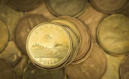 "A Canadian dollar coin, commonly known as the ""Loonie"", is pictured in this illustration picture taken in Toronto January 23, 2015. The Canadian dollar strengthened against the U.S. dollar on Friday after Canadian CPI data showed an increase in core inflation.   REUTERS/Mark Blinch"