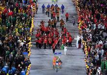 2016 Rio Olympics - Opening ceremony - Maracana - Rio de Janeiro, Brazil - 05/08/2016. Flagbearer Shehzana Anwar (KEN) of Kenya leads her contingent during the opening ceremony.      REUTERS/Richard Heathcote/Pool