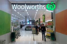 A shopper walks out of a Woolworths store in Sydney, Australia, May 12, 2016. Picture taken May 12, 2016.      REUTERS/David Gray