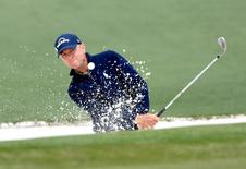 Apr 10, 2016; Augusta, GA, USA; Davis Love III hits out of a bunker on the 2nd hole during the final round of the 2016 The Masters golf tournament at Augusta National Golf Club. Michael Madrid-USA TODAY Sports