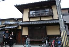 "Sae Cardonnel and her French husband Sylvain stand in front of their traditional Kyoto ""machiya"" townhouse, which was restored with a specialized loan from a Kyoto Shinkin Bank, in Kyoto, Japan, June 26, 2016. REUTERS/Lisa Twaronite"