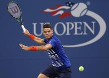 Aug 29, 2016; New York, NY, USA;  Milos Raonic of Canada returns a shot to Dustin Brown of Germany on day one of the 2016 U.S. Open tennis tournament at USTA Billie Jean King National Tennis Center. Mandatory Credit: Jerry Lai-USA TODAY Sports