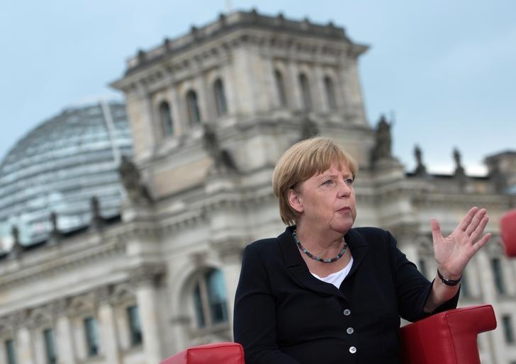 German Chancellor Angela Merkel talks during ARD summer-interview infront of the Reichstag in Berlin, Germany August 28, 2016. REUTERS/Stefanie Loos