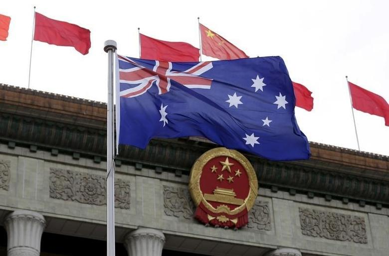 Australian flag flutters in front of the Great Hall of the People during a welcoming ceremony for Australian Prime Minister Malcolm Turnbull (not in picture) in Beijing, China, April 14, 2016. REUTERS/Jason Lee